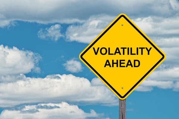 Yellow diamond shaped sign labeled volatility ahead.