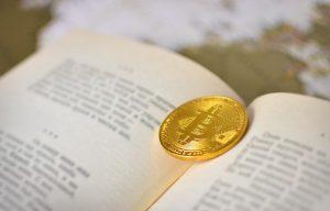 Bitcoin book with a gold bitcoin coin.