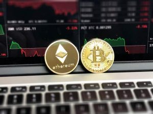 Gold ethereum coin and gold bitcoin coin.
